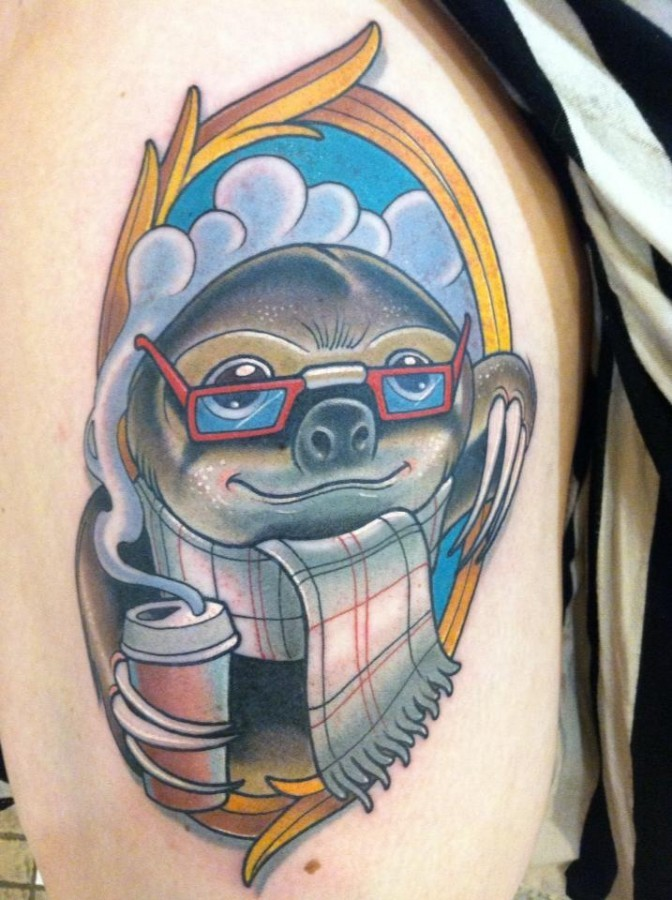 Funny cartoon like sloth portrait tattoo on shoulder