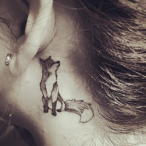 Funny cartoon style painted black ink behind ear tattoo of little fox