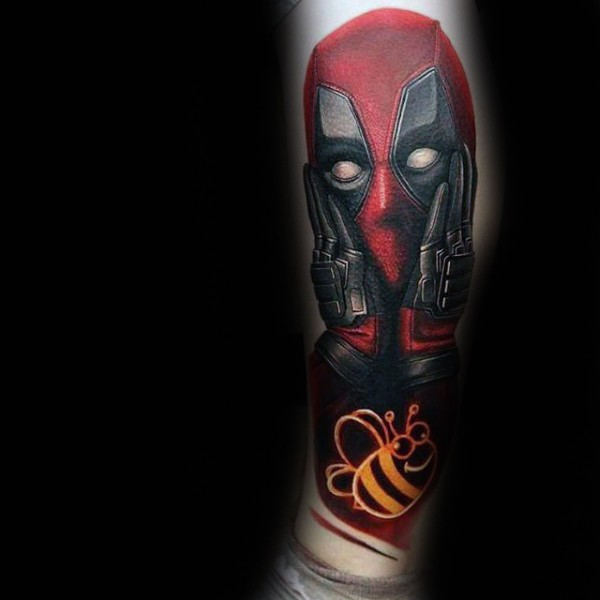 Funny painted and colored arm tattoo of Deadpool with small bee