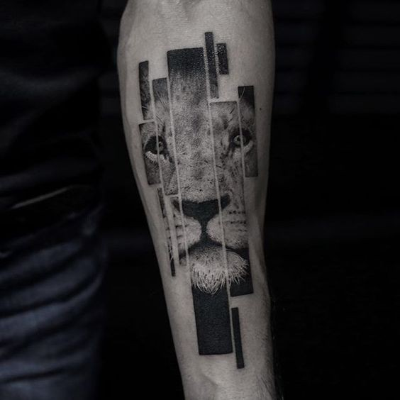 Geometrical style black ink forearm tattoo of lion portrait