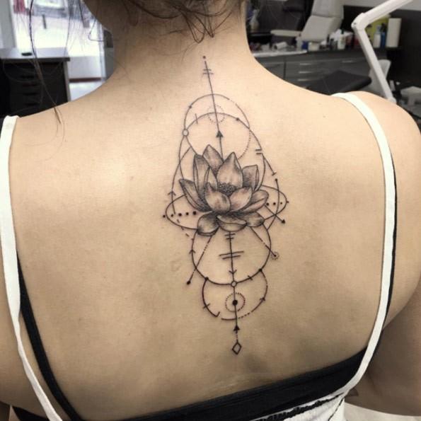 Geometrical style black ink upper back tattoo of geometrical figure and cute flower