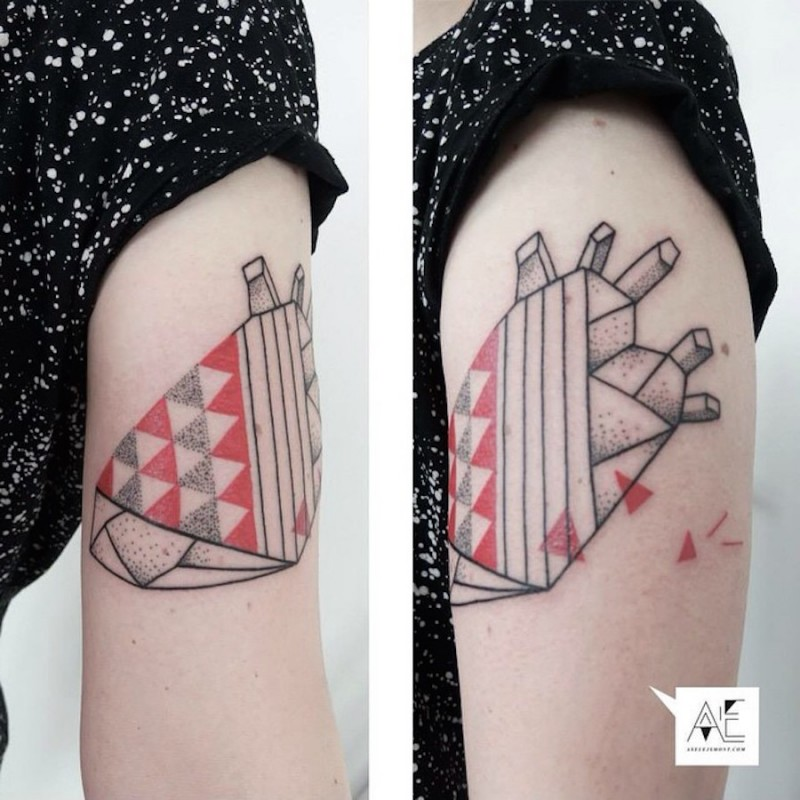 Geometrical style colored arm tattoo of human heart with ornaments