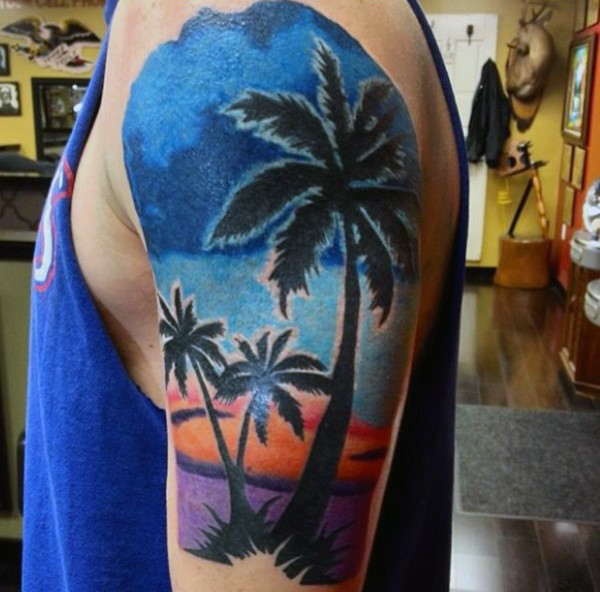Gorgeous colorful sunset with palm trees tattoo on half sleeve zone