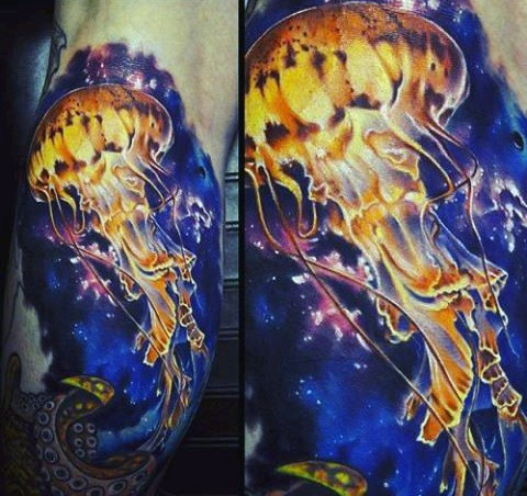 Gorgeous detailed and colored massive jellyfish tattoo on arm