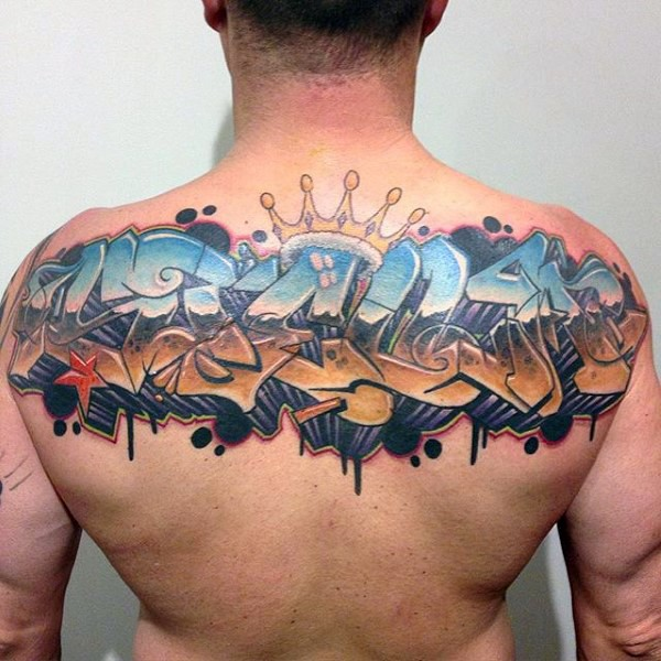 Graffiti style colored lettering tattoo on back with crown