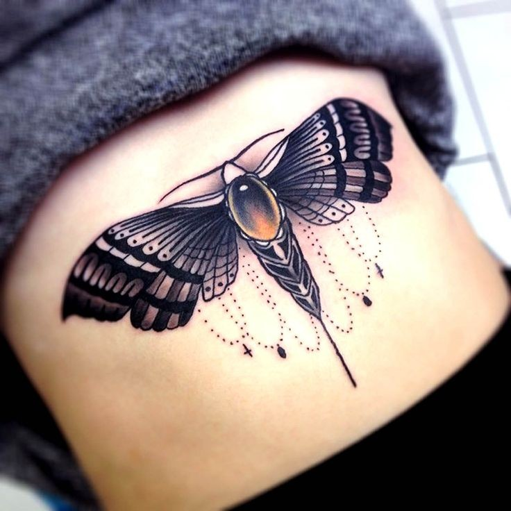 Great black bug tattoo on stomach