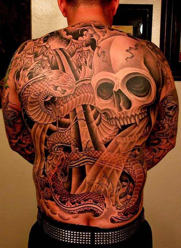 Great skull with snake tattoo on whole back