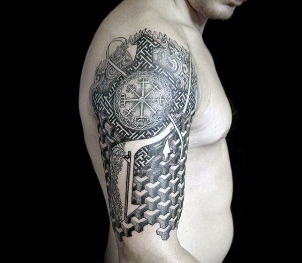 Half geometric half ornamental style tattoo on shoulder