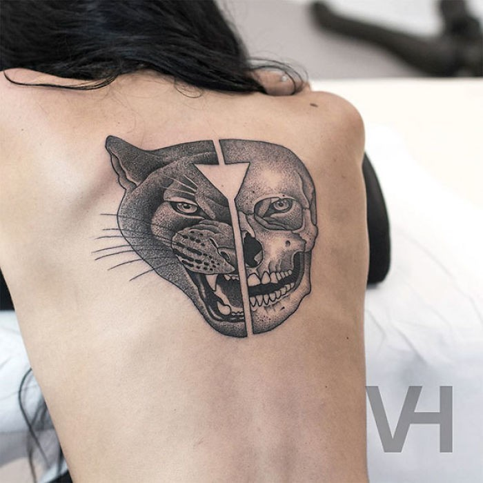 Half geometrical style black ink upper back tattoo of split panther and human head by Valentin Hirsch