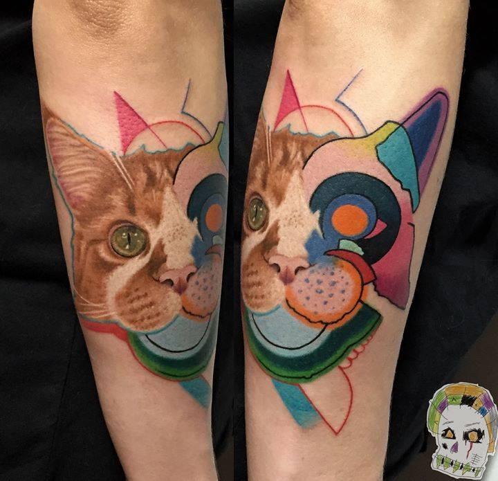 Half realistic half illustrative style colored arm tattoo of cat head