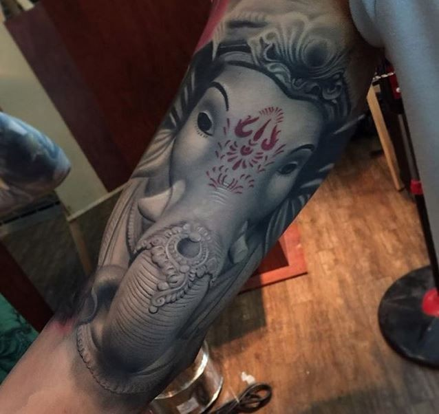 Hinduism style colored arm tattoo of saint elephant