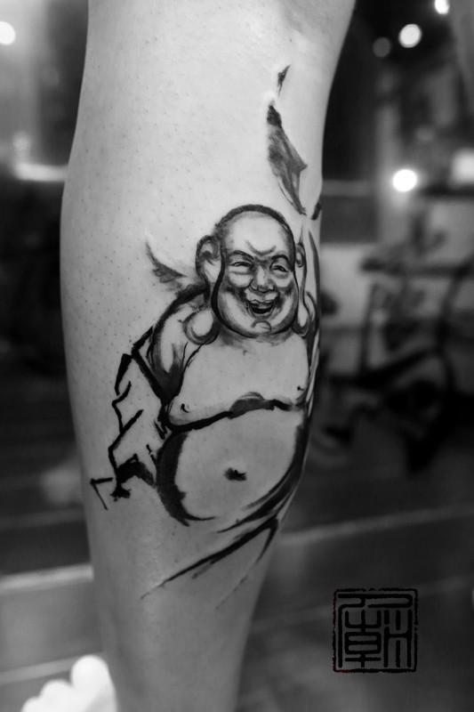 Homemade style black ink leg tattoo of funny Buddha statue