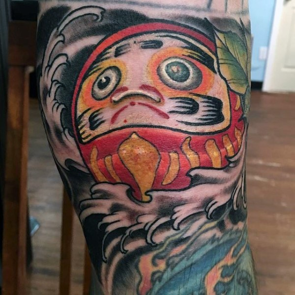 Homemade style colored leg tattoo of funny daruma doll with leaves