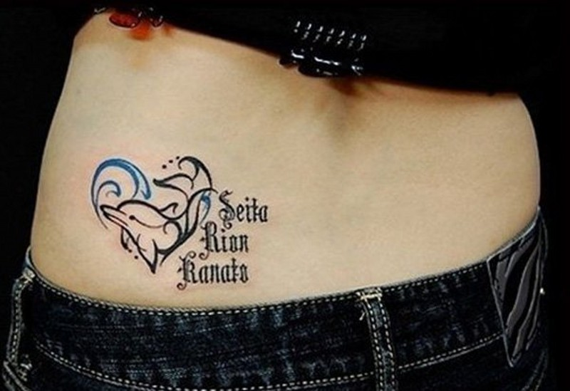 Homemade style colored little dolphin with lettering tattoo on hip