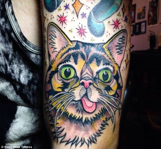 Homemade style colored shoulder tattoo of funny cat with stars