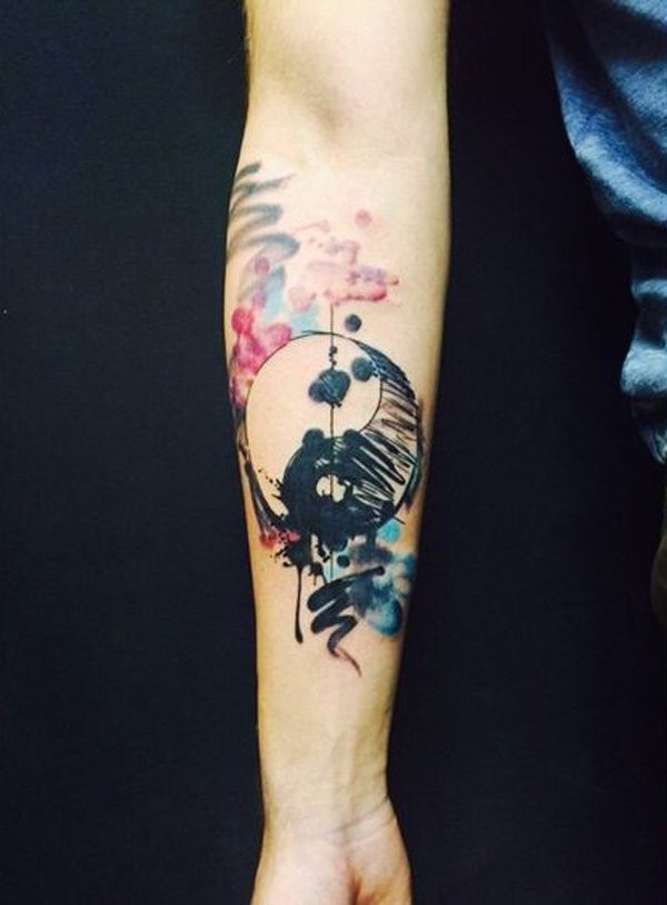 Homemade watercolor style forearm tattoo of Yin Yang symbol
