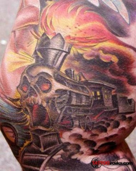 Horror style colored large arm tattoo of demonic train with skull and flames