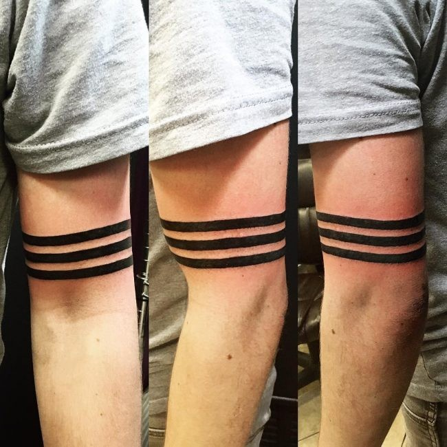 Identical black ink biceps tattoo of straight lines