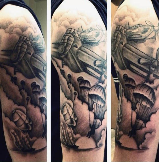 Illustrative style black ink WW2 military plane with paratroopers tattoo on upper arm