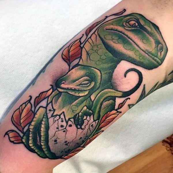 Illustrative style colored arm tattoo of dinosaur family