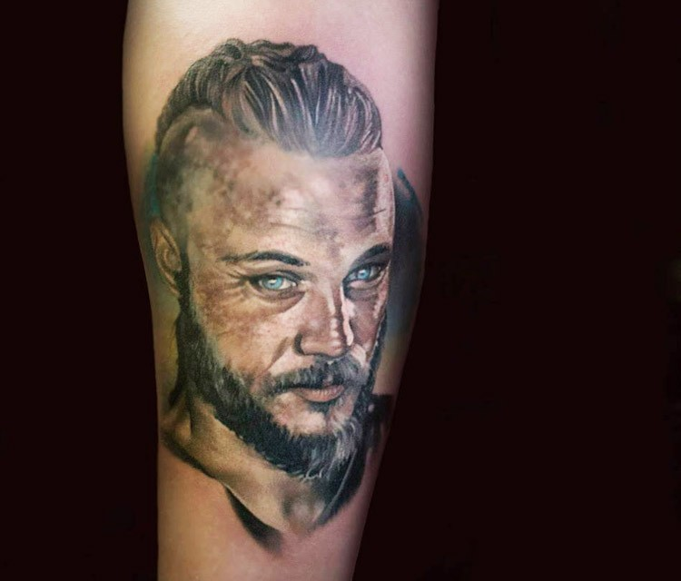 Illustrative style colored arm tattoo of viking face