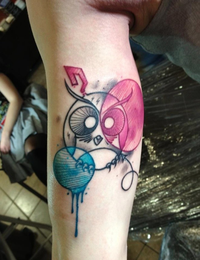 Illustrative style colored biceps tattoo of funny owl with circles