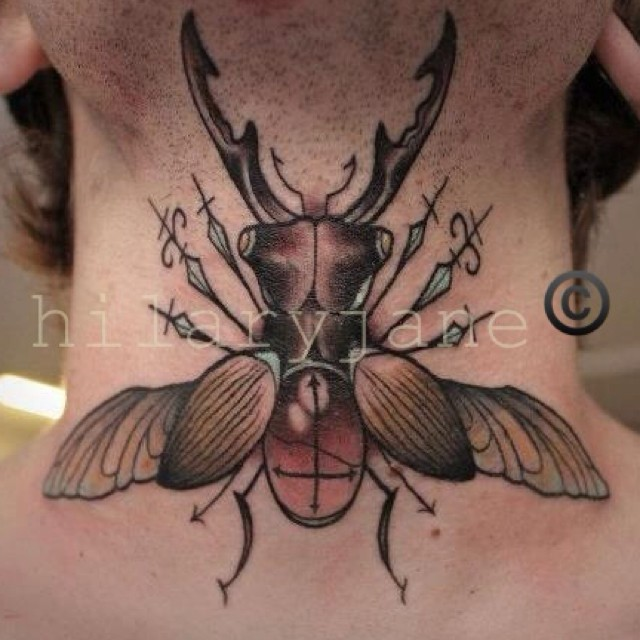 Illustrative style colored big bug tattoo on neck