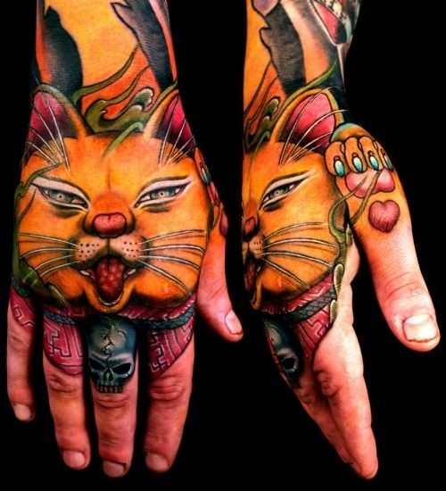 Illustrative style colored hand tattoo of sweet looking cat and red heart