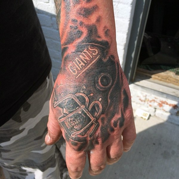 Illustrative style colored hand tattoo of human skull with helmet