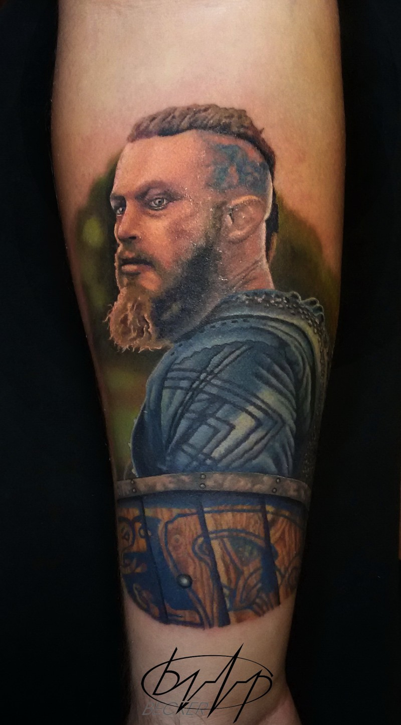 Illustrative style colored leg tattoo of Viking hero