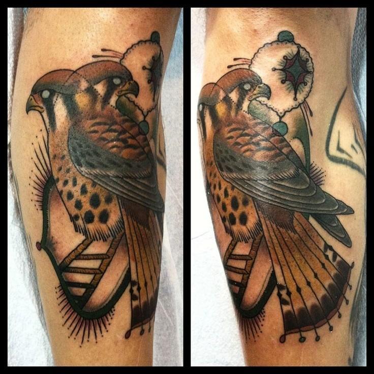 Illustrative style colored leg tattoo of eagle original symbol