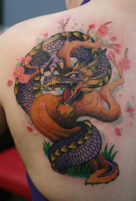 Illustrative style colored scapular tattoo of fantasy dragon with blooming tree
