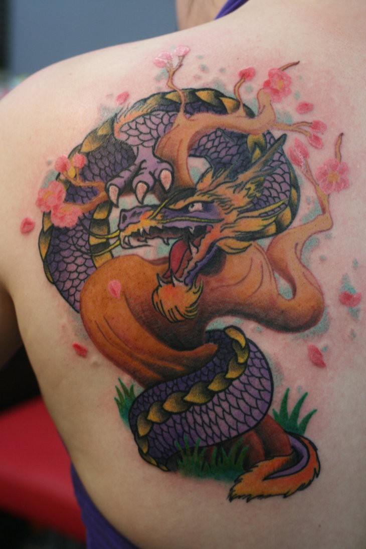 Illustrative style colored scapular tattoo of big dragon with tree