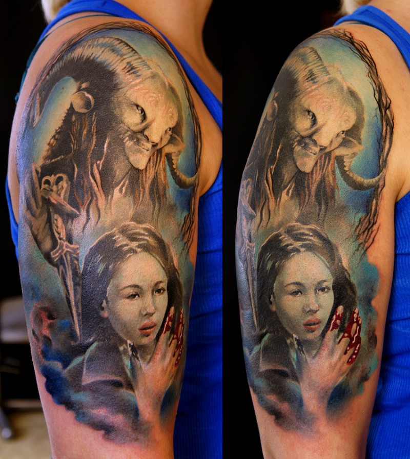 Illustrative style colored shoulder tattoo of demon face with bloody woman