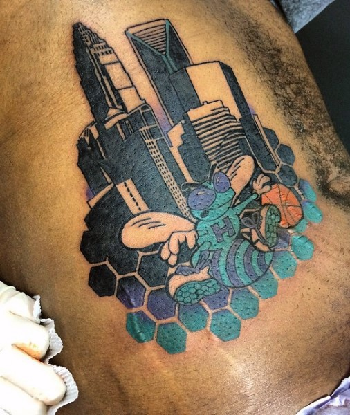 Illustrative style colored side tattoo of bee in city