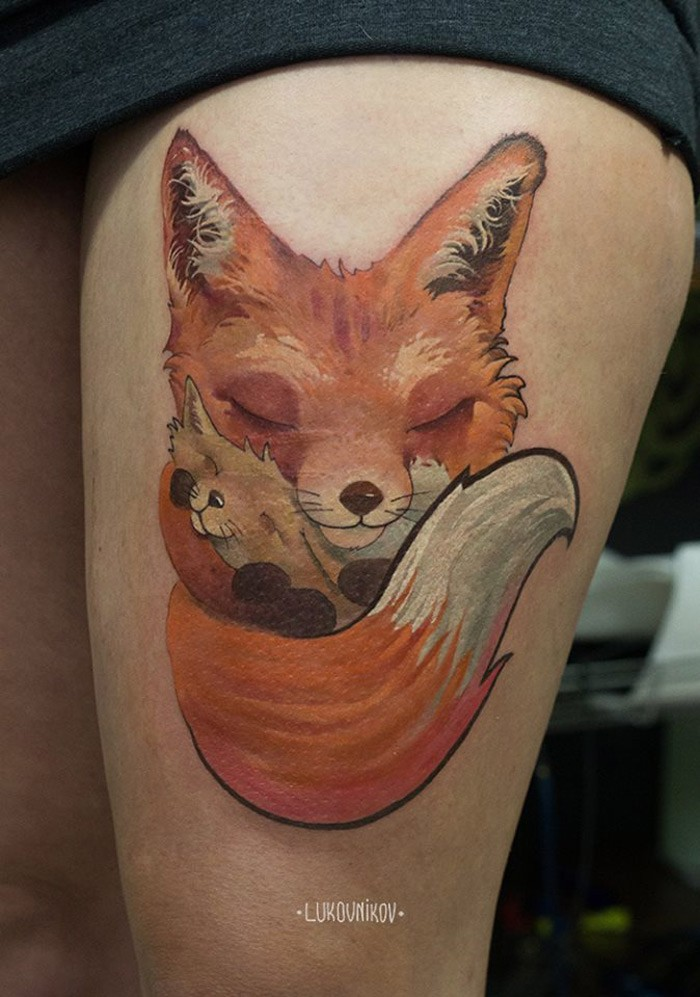 Illustrative style colored thigh tattoo of cute fox family