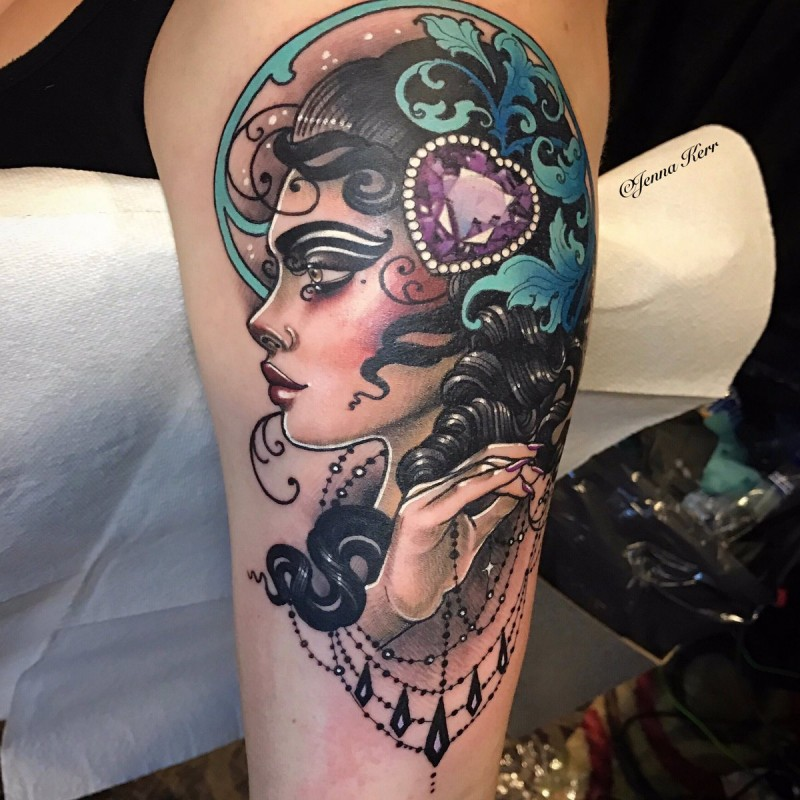 Illustrative style designed by Jenna Kerr upper arm tattoo of woman with hear shaped diamond