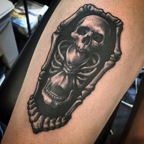 Impressive black and white skeleton with bone shaped coffin tattoo on leg