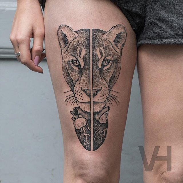 Impressive dot style designed by Valentin Hirsch thigh tattoo of symmetrical lion head with human heart