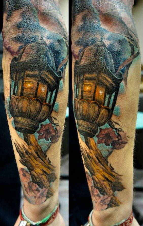 Impressive looking arm tattoo of vintage city lighter with tree branch