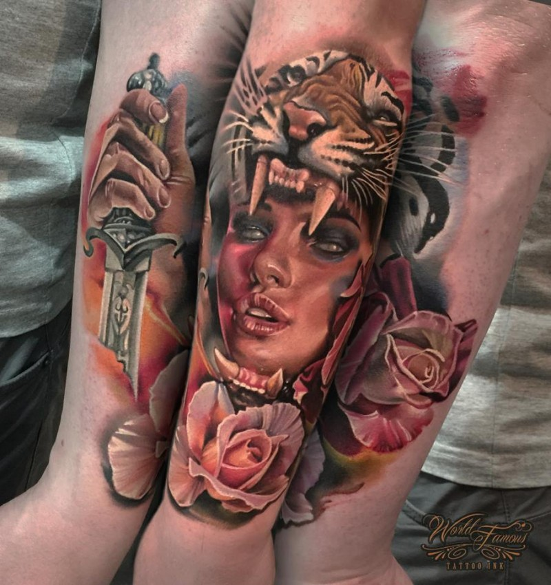 Impressive looking colored arm tattoo of tribal woman with tigers helmet, rose and dagger