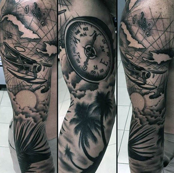 Incredible black and gray style sleeve tattoo of sea plane, compass and palm trees