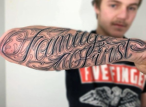 Incredible design lettering family first black ink arm tattoo