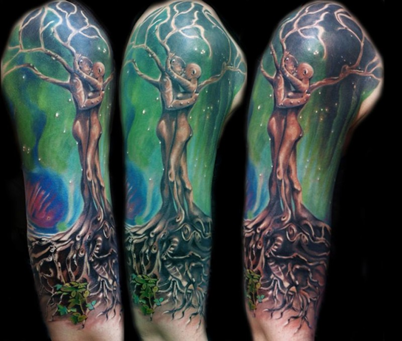 Incredible designed and colored large shoulder tattoo of human shaped fantasy tree