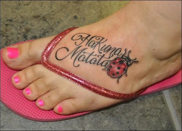 Ladybug hakuna matata tattoo on foot