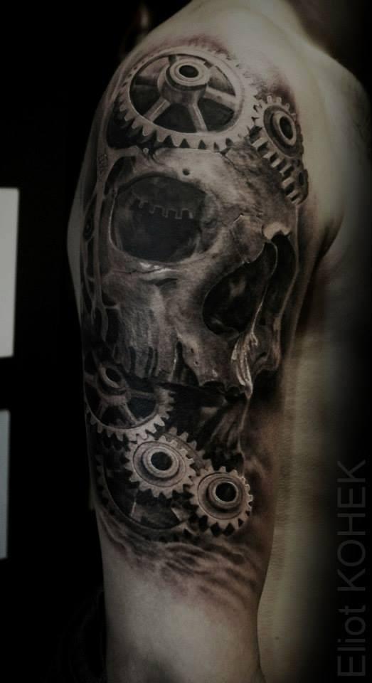 Large 3D style half sleeve tattoo of skull designed by Eliot Kohek