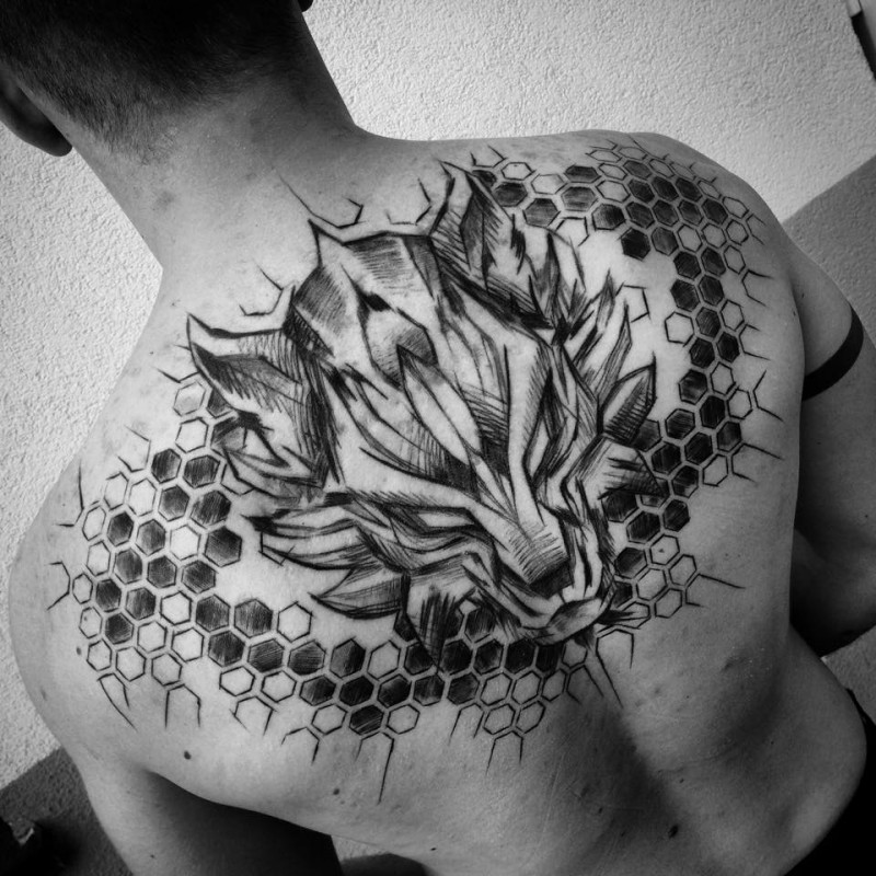 Large beautiful painted by Inez Janiak upper back tattoo of dragon head