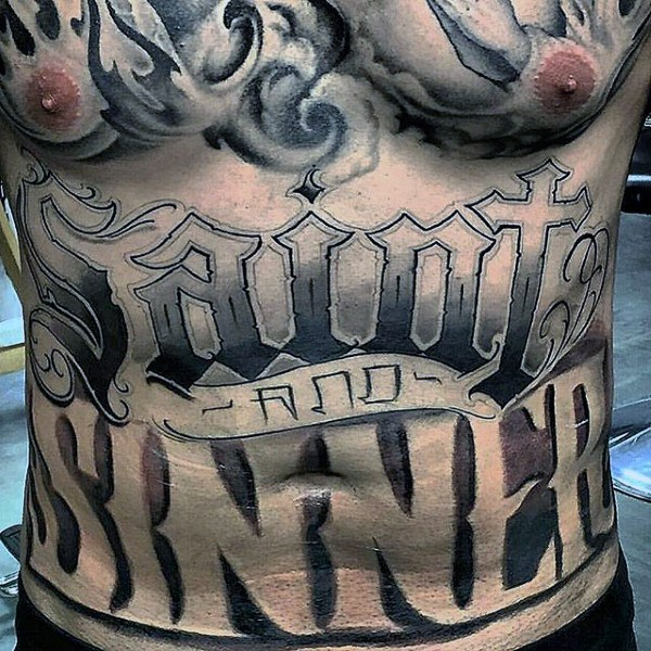 Large black ink ambigram tattoo on belly