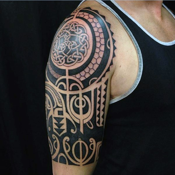 Large black ink Celtic style shoulder tattoo of various ornaments
