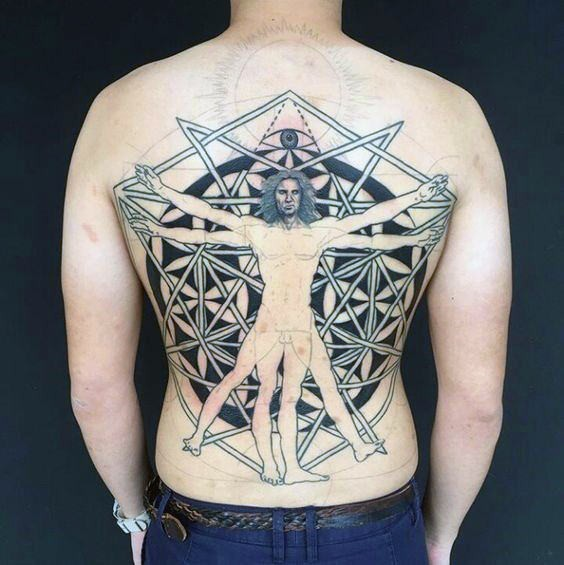 Large blackwork style back tattoo of Vitruvian man combined with geometrical figures and eye
